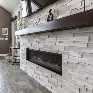 Large classic living room in Other with grey walls, porcelain flooring, a stone fireplace surround, a wall mounted tv, grey floors and a ribbon fireplace.