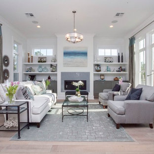 Inspiration for a mid-sized transitional open concept and formal light wood floor and beige floor living room remodel in New Orleans with white walls, a standard fireplace, a tile fireplace and no tv