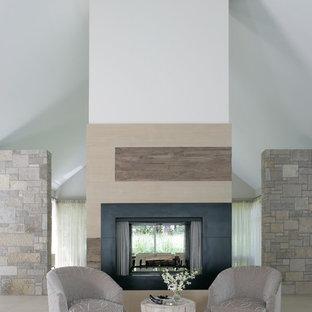 Ispirazione per un soggiorno country di medie dimensioni e stile loft con sala formale, pareti grigie, nessuna TV, pavimento in pietra calcarea e camino bifacciale