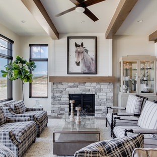 This is an example of a country formal open concept living room in Salt Lake City with beige walls, a standard fireplace, a stone fireplace surround, no tv and light hardwood floors.