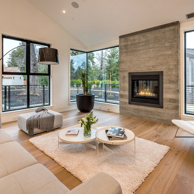 Example of a danish light wood floor living room design in San Francisco with white walls and a ribbon fireplace