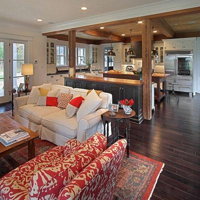Example of a classic open concept dark wood floor and brown floor living room design in Richmond
