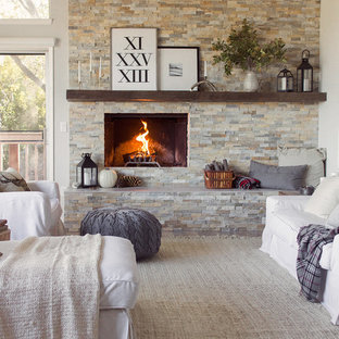 Example of a large cottage open concept light wood floor and gray floor living room design in Tampa with gray walls, a standard fireplace and a stone fireplace