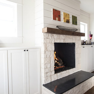 Inspiration for a mid-sized cottage dark wood floor living room remodel in Dallas with a standard fireplace, a stone fireplace and no tv