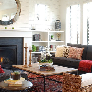 Inspiration for a small country open concept living room remodel in Boise with white walls and a standard fireplace