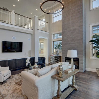 Large transitional formal and enclosed dark wood floor and brown floor living room photo in San Francisco with beige walls, a standard fireplace, a tile fireplace and a wall-mounted tv