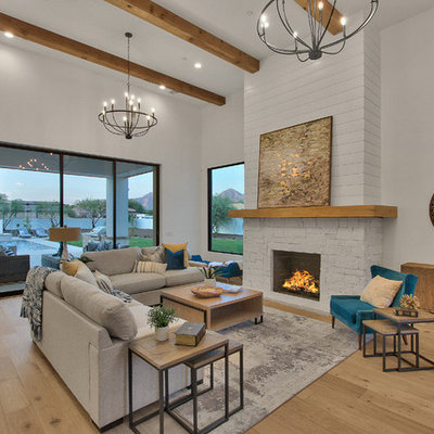 Inspiration for a farmhouse open concept light wood floor and beige floor living room remodel in Phoenix with white walls, a standard fireplace and a stone fireplace