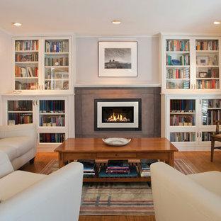 ポートランドの中サイズのトランジショナルスタイルのおしゃれな独立型リビング (フォーマル、白い壁、濃色無垢フローリング、標準型暖炉、コンクリートの暖炉まわり、テレビなし) の写真