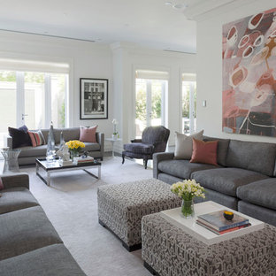 Photo of an expansive contemporary formal open plan living room in Melbourne with white walls, carpet, a standard fireplace, a plastered fireplace surround, a concealed tv and pink floors.