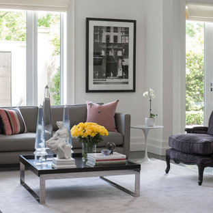Design ideas for an expansive contemporary formal open plan living room in Melbourne with white walls, carpet, a standard fireplace, a plastered fireplace surround, a concealed tv and pink floors.