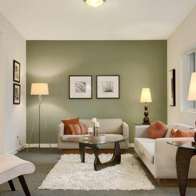 Inspiration for a transitional enclosed living room remodel in Seattle with green walls