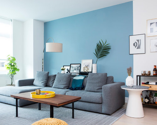 Trendy Beige Floor Living Room Photo In New York With A Bar And Blue Walls