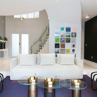 Example of a large minimalist formal and open concept marble floor and turquoise floor living room design in Miami with gray walls and no tv