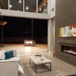 Living room - huge modern open concept porcelain floor and gray floor living room idea in Phoenix with a bar, blue walls, no fireplace, a stone fireplace and a wall-mounted tv