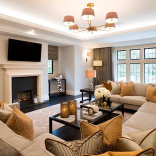 This is an example of a medium sized classic living room in West Midlands with beige walls and black floors.