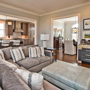 Ejemplo de salón abierto, clásico renovado, sin chimenea y televisor, con paredes grises, suelo de madera en tonos medios y suelo marrón