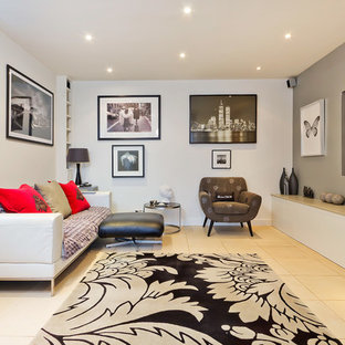 Example of a trendy enclosed living room design in Sussex with white walls and a wall-mounted tv