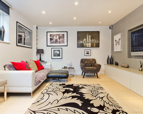 Example Of A Trendy Enclosed Living Room Design In Sussex With White Walls  And A Wall