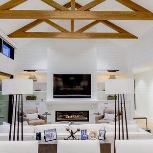 Exemple d'un salon nature avec un mur blanc, un sol en bois clair, une cheminée ribbon, un manteau de cheminée en bois, un téléviseur fixé au mur et un sol beige.