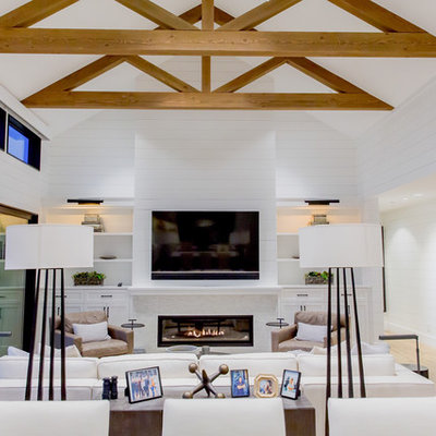 Inspiration for a cottage light wood floor and beige floor living room remodel in Seattle with white walls, a ribbon fireplace, a wood fireplace surround and a wall-mounted tv