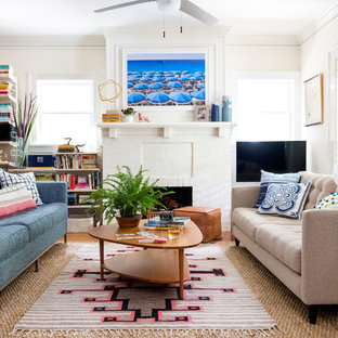 Inspiration for a medium sized eclectic open plan living room in Atlanta with white walls, a standard fireplace, a brick fireplace surround and a freestanding tv.