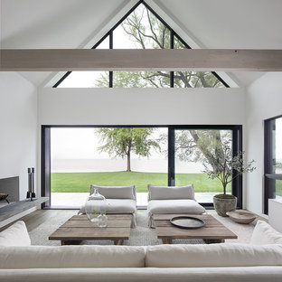 Example Of A Minimalist Open Concept Light Wood Floor Living Room Design In Milwaukee With White
