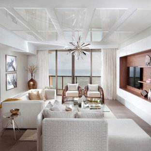 Example of a large trendy living room design in Miami with white walls and a wall-mounted tv