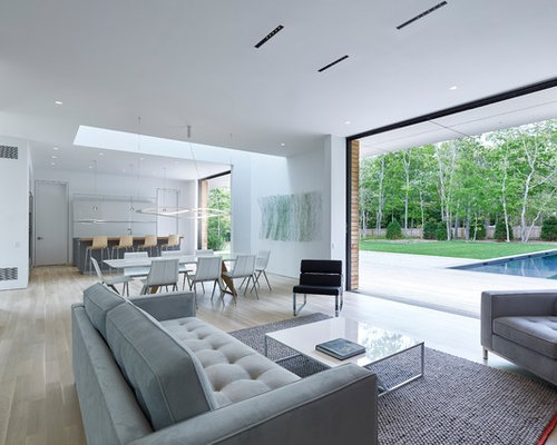 Example Of A Minimalist Open Concept Living Room Design In New York With  White Walls,