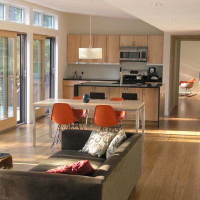 Example of a minimalist open concept living room design in New York