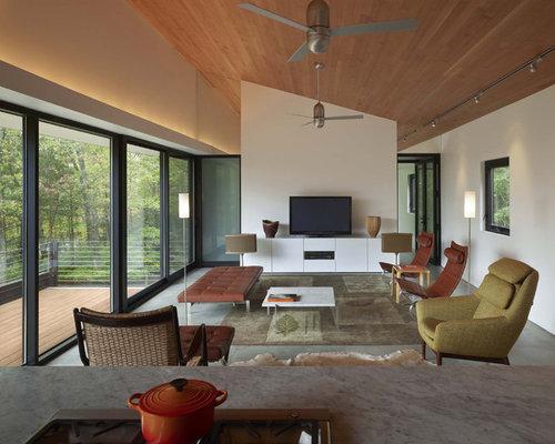photos et id es d co de pi ces vivre avec un sol en b ton plafond rampant. Black Bedroom Furniture Sets. Home Design Ideas