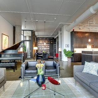 Foto de salón con rincón musical abierto, moderno, con suelo de cemento