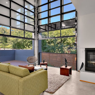 Ejemplo de salón urbano con suelo de cemento y chimenea de esquina