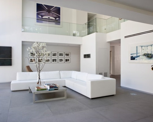 Example Of A Minimalist Formal Living Room Design In Kansas City With Limestone Floors White