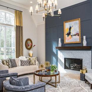Foto de salón para visitas clásico renovado, sin televisor, con suelo beige, paredes grises, chimenea tradicional y marco de chimenea de piedra