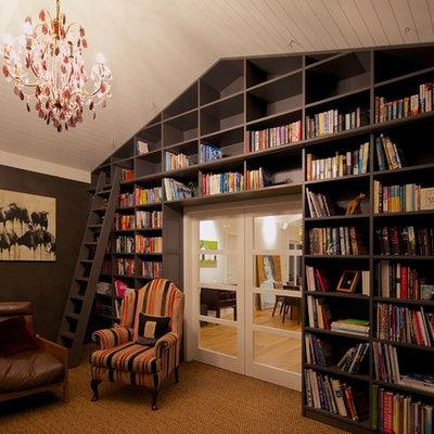 Minimalist living room library photo in Hamilton