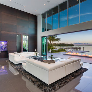 This is an example of a contemporary open plan living room in Miami with marble flooring.