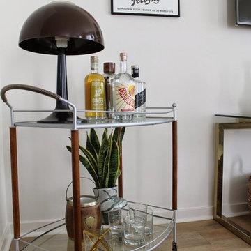 Modern Living Room with Vintage Bar Cart and Mushroom Lamp