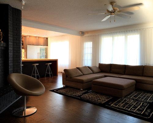 Medium sized black living room design ideas renovations for Medium sized living room