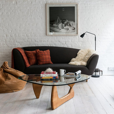 Example of an urban formal and open concept light wood floor living room design in London with white walls and a tv stand