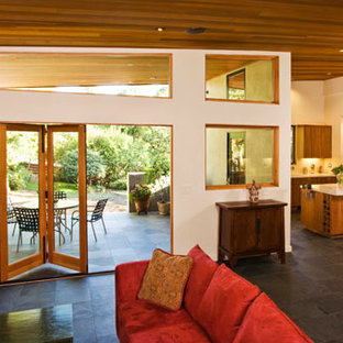 Living room - large modern formal and open concept slate floor living room idea in San Francisco with white walls and no tv
