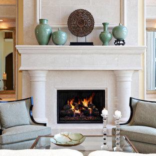マイアミの中くらいの地中海スタイルのおしゃれな独立型リビング (石材の暖炉まわり、黄色い壁、フォーマル、標準型暖炉、テレビなし) の写真