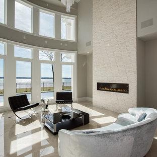 Ispirazione per un grande soggiorno minimalista aperto con sala formale, pareti grigie, pavimento in marmo, camino sospeso, cornice del camino in pietra, nessuna TV e pavimento beige