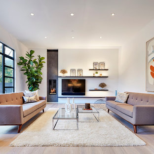 Inspiration for a contemporary formal light wood floor living room remodel in San Francisco with white walls, a ribbon fireplace and a wall-mounted tv