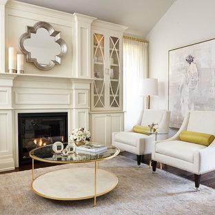 Foto de salón para visitas cerrado, actual, grande, sin televisor, con paredes blancas, chimenea tradicional, suelo de madera oscura y marco de chimenea de madera