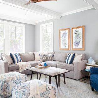 Transitional open concept medium tone wood floor living room photo in New York with gray walls