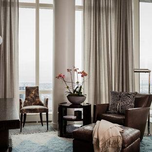 ボストンのトランジショナルスタイルのおしゃれな独立型リビング (グレーの壁、カーペット敷き、グレーの床、壁掛け型テレビ) の写真