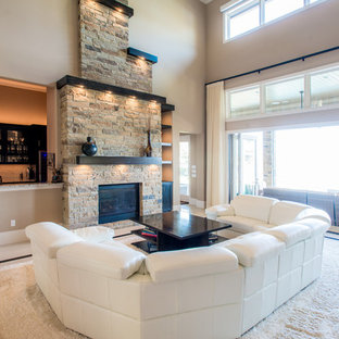 Inspiration for a large modern open concept porcelain tile living room remodel in Houston with a bar, beige walls, a standard fireplace and a stone fireplace
