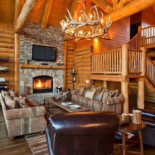 Example Of A Mountain Style Living Room Design In Dallas With A Stone  Fireplace