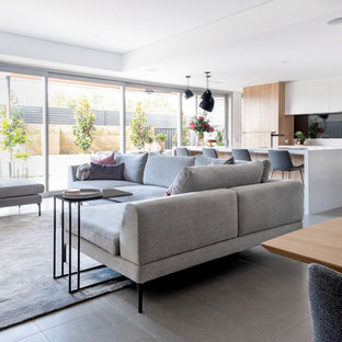 Design ideas for a scandinavian open concept living room in Perth with white walls and grey floor.