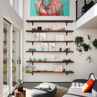 Danish open concept concrete floor and gray floor living room photo in New York with white walls